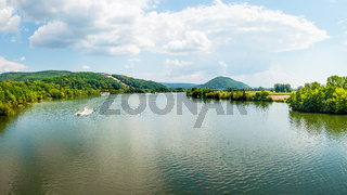 Panoramic landscape, Danube River and Walhalla memorial on the hill, tourism and famous places, Donaustauf, Germany, banner 16x9 format