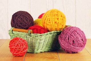 Different Yarn Balls In Wooden Basket
