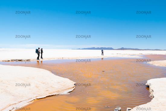 Bolivia Colchani hikers in the Salar of Uyuni