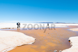 Bolivia Colchani hikers in the Salar of Uyuni