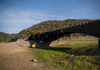 Bridge of the village Asel with the dry lake Edersee