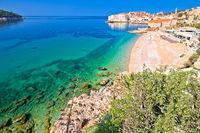 Dubrovnik. Banje beach and historic walls of Dubrovnik view