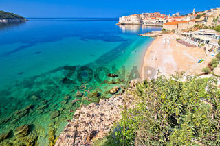 Dubrovnik. Banje beach and historic walls of Dubrovnik view