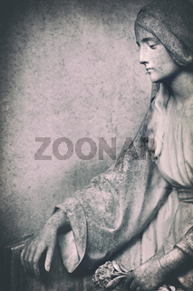 portrait of a weathered stone maria sculpture