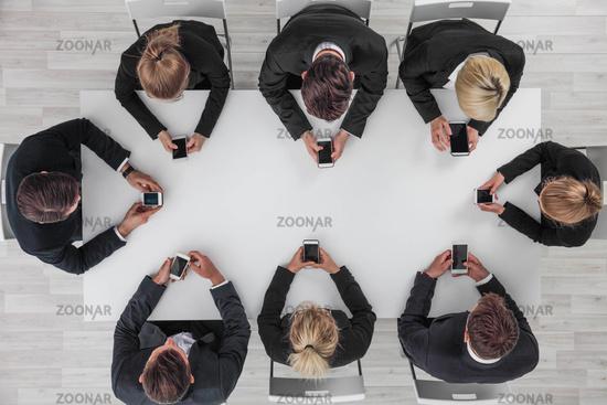 Business people using smartphones