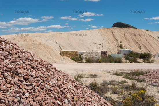 surface quarry with stock of gravel