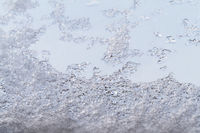 Natural ice and water drops on glass background
