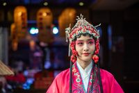 Portrait of a yound woman dressed in Sichuan Opera traditional costume