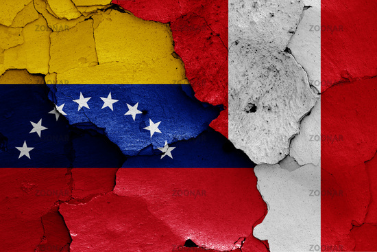 flags of Venezuela and Peru painted on cracked wall