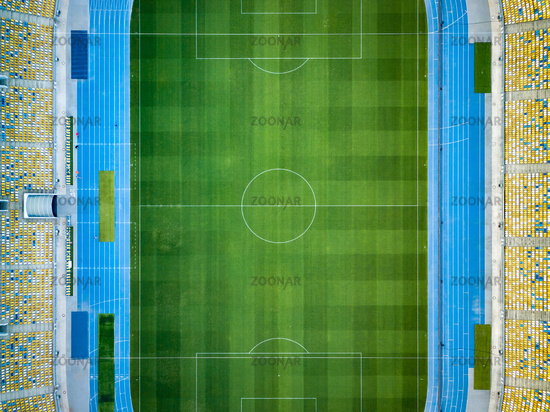 KYIV, UKRAINE - July 19, 2018. NSC Olimpiysky. Aerial view from drone of construction of green football field, tribunes before the game. Top view