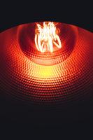 Light bulb inside copper lamp.