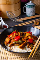 Hot roasted chicken with rice and vegetables