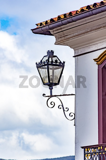 Old light lantern and colonial style house facade