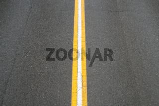 white line on asphalt road - two lane street -