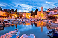 Krk. Town of Malinska waterfront and harbor dawn view