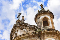 Ancient historical catholic church tower, ornaments and crucifix