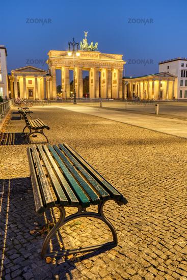 The Pariser Platz in Berlin at dawn with the illuminated Brandenburg Gate in the back