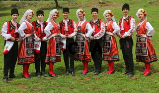 Vratsa, Bulgaria - June 24, 2018: People in traditional authentic folklore costume a meadow near Vratsa, Bulgaria