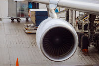 jet engine against a plane at the airport on loading