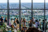 Tourists visiting, Sky Gardens in London, panorama of London seen from above. 03.07.2018