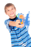 Young boy with water pistol