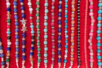Colorful stone bracelets and necklaces for sale.