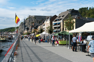 people enjoying and visiting the riverside market and stalls on the Maas River in Dinant