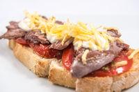 Toast of Iberian pork sirloin on a natural tomato base