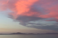 Sunset on the sea in Sardinia with red glowing clouds