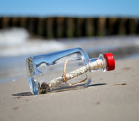 A washed-up bottle post on the beach