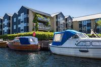 Boats in front of Houses along Canal in Copenhagen, Denmark