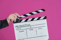 movie clapper on pink background