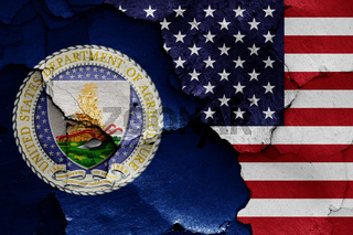 flags of Department of Agriculture and USA painted on cracked wall
