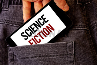 Conceptual hand writing showing Science Fiction. Business photo showcasing Fantasy Entertainment Genre Futuristic Fantastic Adventures Man holding cell phone white screen letters on jeans pocket.