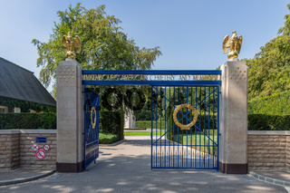 Entrance American WW2 Cemetery with iron gate and gold eagles