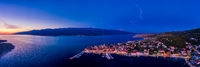 Sunset over town in Croatia, aerial panorama of Vinjerac, near Zadar