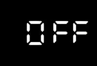 Real white led digital clock on a black background showing OFF