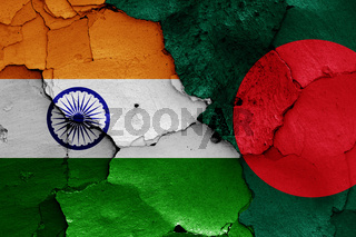 flags of India and Bangladesh painted on cracked wall