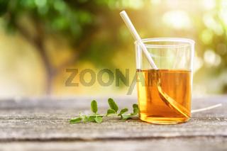 verbena tea on old wooden planks