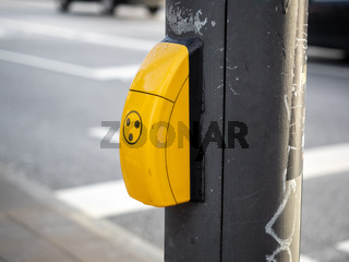 Button on the traffic light for blind people