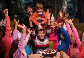 happy young boy having birthday party