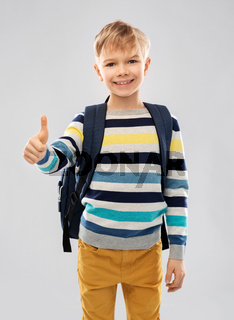 student boy with school bag showing thumbs up