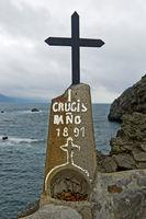 Black metallic cross on a rock above the Bay of Biscaya,islet of San Juan de Gaztelugatxe,Spain