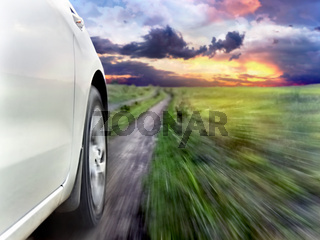 View of the front of a silver car while driving fast