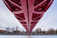 CALGARY, ALBERTA, CANADA - MARCH 19, 2013: The Peace Bridge over the frozen Bow River in downtown Calgary, Alberta