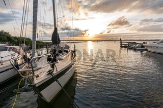 Marina with sailing boats during dramatic sunset