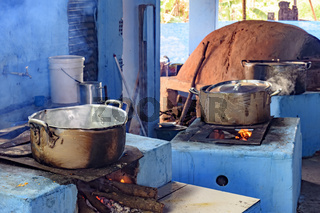 Rustic kitchen in the interior of Brazil with wood stove and oven of clay
