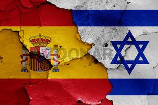 flags of Spain and Israel painted on cracked wall
