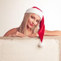 Santa girl holding vintage billboard