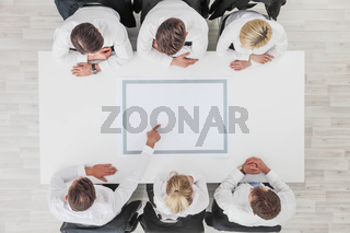 Business team pointing to blank paper